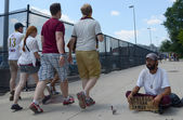 People walking past homeless veteran — Stock Photo