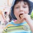 Boy eating chips — Stock Video #12292857