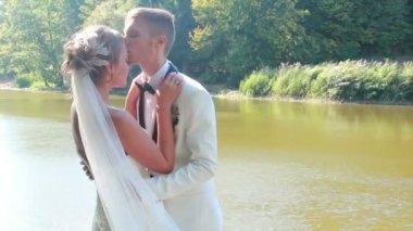 Groom kisses the bride — Stock Video