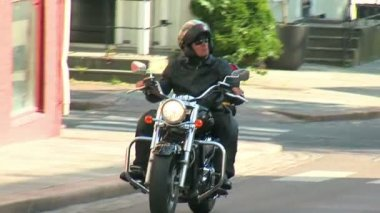 Biker on city road — Stockvideo