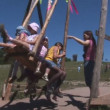 Kids ride on a swing — Stock Video