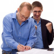 Person signing of an agreement — Stock Photo #12043043