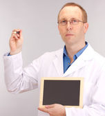 Medical doctor with blackboard — Stock Photo