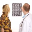 Stock Photo: Male medical doctor examining female patient