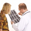 Medical doctor examining a patient — Stock Photo #12605214