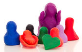 Modelling clay figures with a heart — Stock Photo