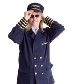 Female pilot putting on her cap — Stock Photo
