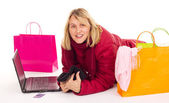 Attractive woman shopping over the internet — Stock Photo