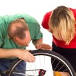 Stock Photo: Mechanic repairs wheel of bicycle