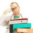 Medical doctor with a lot of work — Stock Photo