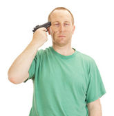 Depressive man with a gun — Stock Photo
