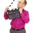 A male business person with a clapperboard — Stock Photo #13164381
