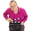 A male business person with a clapperboard — Stock Photo #13164379