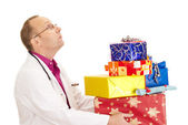 Doctor with a lot of gifts — Stock Photo