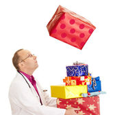 A doctor catching a very big gift — Stock Photo