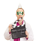 A male medical doctor with a clapperboard — Stock Photo