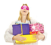 Medical doctor with some colorful gifts — Stock Photo