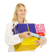 Medical doctor with some gifts — Stock Photo