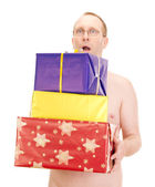 Nude man with some gifts — Stock Photo
