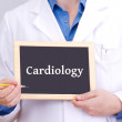 Doctor shows information on blackboard: cardiology — Stock Photo