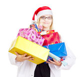 Medical doctor with a lot of christmas gifts — Stock Photo