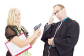 Young woman hold a lawyer at gunpoint — Stock Photo