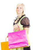 Woman in traditional costume with shopping bags — Stock Photo