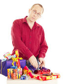 Person packaging some colorful gifts — Stok fotoğraf