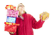 A female person throwing a colorful gift — Stock Photo