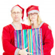 Two santas with a gift — Stock Photo #13782610