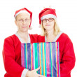 Two santas with a gift — Stock Photo
