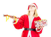 Santa claus juggling with gifts — Stock Photo
