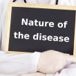 Doctor shows information: nature of the disease — Stock Photo