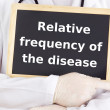 Stock Photo: Doctor shows information: relative frequency of disease