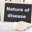 Doctor shows information: nature of disease — Stock Photo