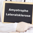 Doctor shows information: amyotrophic lateral sclerosis — Stock Photo