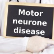 Stock Photo: Doctor shows information: motor neurone disease