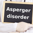 Stock Photo: Doctor shows information: asperger disorder