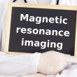 Doctor shows information: magnetic resonance imaging — Stock Photo