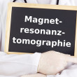 Doctor shows information: magnetic resonance imaging — Stock Photo #13969338