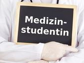 Doctor shows information on blackboard: medical student — Stock Photo