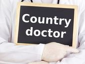 Doctor shows information on blackboard: country doctor — Stockfoto