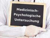 Doctor shows information on blackboard: medical-psychological assessment — Stock Photo