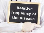 Doctor shows information: relative frequency of the disease — Photo