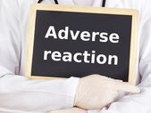 Doctor shows information on blackboard: adverse reaction — 图库照片