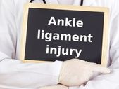 Doctor shows information: ankle ligament injury — Stock Photo