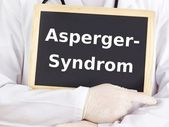 Doctor shows information: asperger syndrome — Stock Photo
