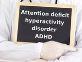Doctor shows information on blackboard: adhd — Stock Photo