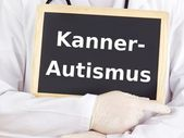 Doctor shows information: early infantile autism — Stock Photo