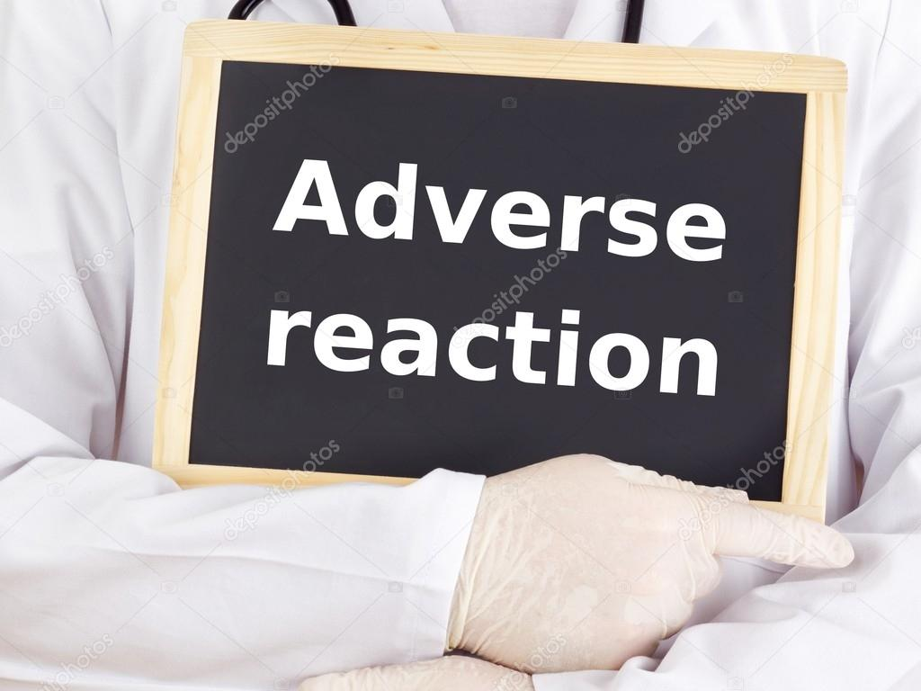 Doctor shows information on blackboard: adverse reaction — Stock Photo #13968130